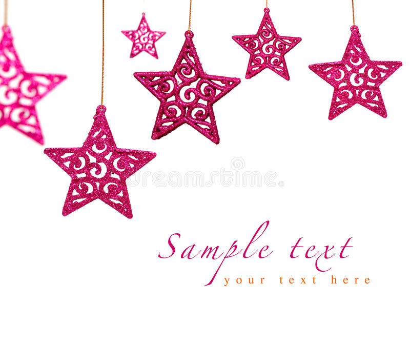 Christmas red stars. Hanging on sparkling background with bokeh effect