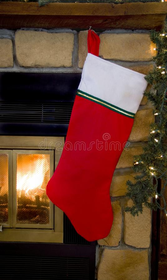 Christmas Red Stocking Hanging on Fireplace stock images