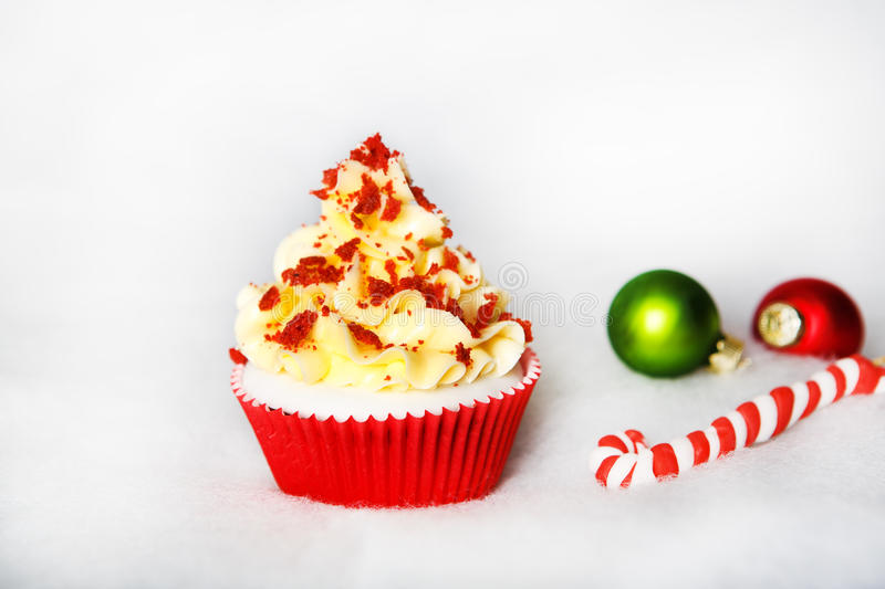 Christmas red velvet cupcake with white fondant frosting. Christmas red velvet cupcake with white fondant royalty free stock photography