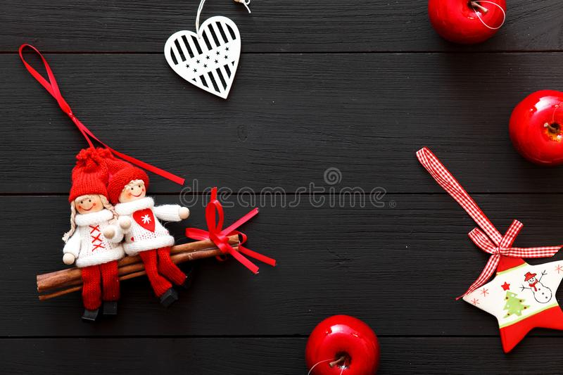 Handmade red white Christmas decorations on black wooden background, happy new 2018 year Valentines Day card, top view stock photography