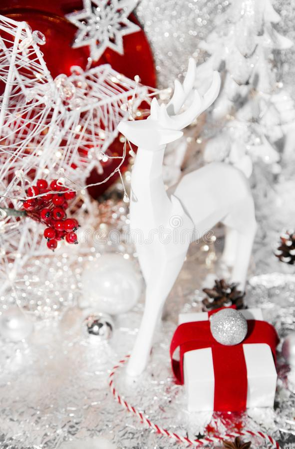 Christmas red, xmas white reindeer, red plate, gift, red ribbon, mountain ash, rowan, christmas tree and balls, on white royalty free stock images