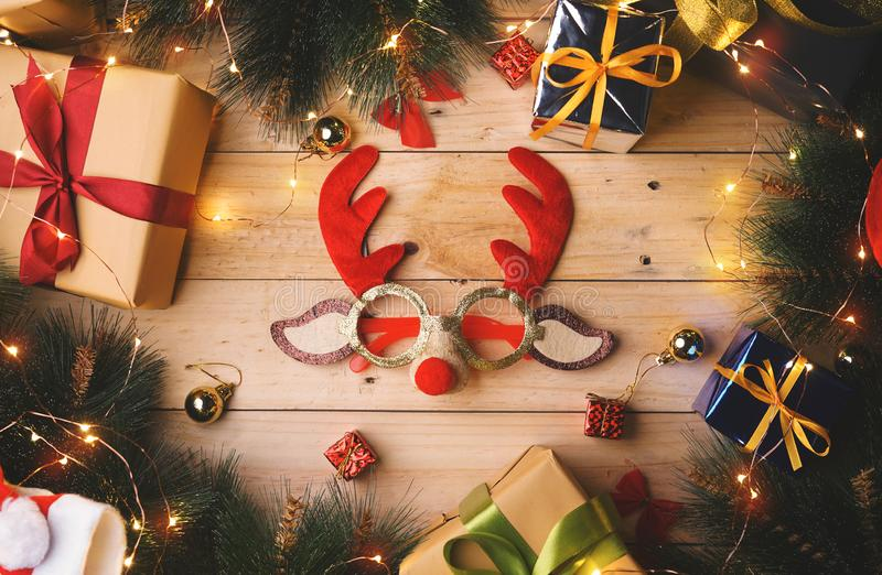 Christmas Reindeer Glasses Surrounded By Christmas Gifts Ornament stock images