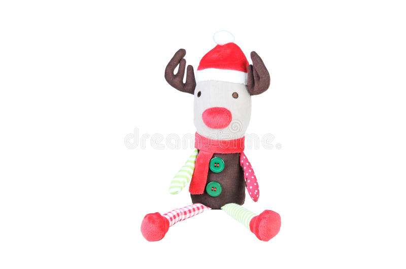 Christmas reindeer toy on white background. Soft Toy Reindeer. Reindeer with Santa hat isolated with a red christmas hat stock images