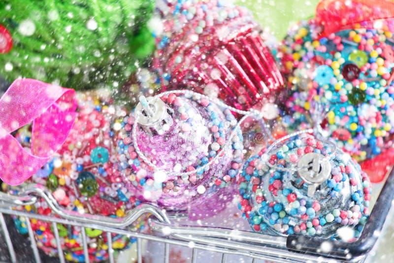 Christmas retro tree toy. Christmas retro tree cupcake toys in shopping basket over snow royalty free stock photo