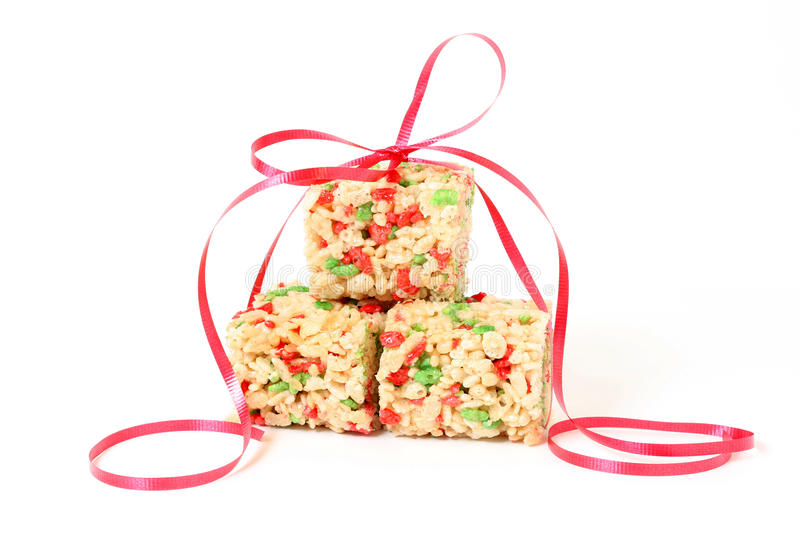 Christmas Rice Krispie squares with ribbon. Festive marshmallow Rice Krispie squares with a red ribbon royalty free stock images