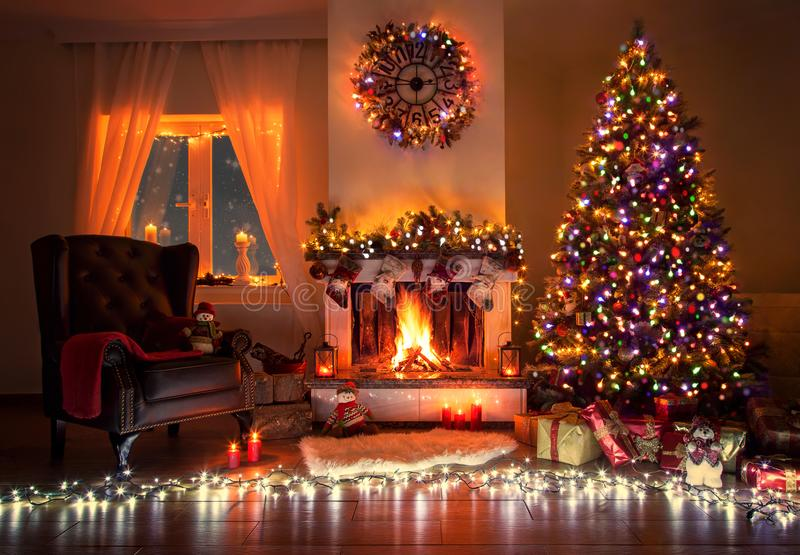Beautiful decorated living room with a christmas tree and a fire place. Christmas room beautiful decorated, warm with fire place , christmas tree and many lights stock photography