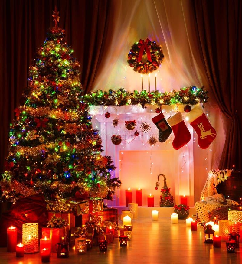 Christmas Room and Lighting Xmas Tree, Magic Interior Fireplace. Hanging Socks stock photo