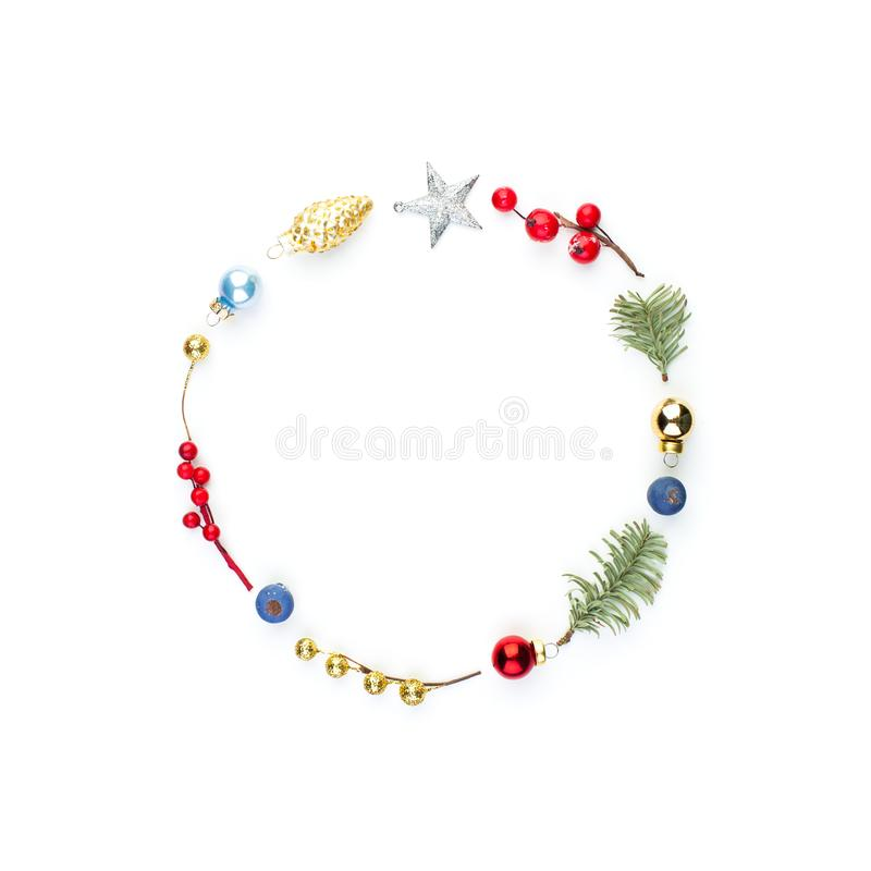Christmas round composition frame with holly berries, silver star and green fir branch isolated on white background. Xmas flat lay royalty free stock photo