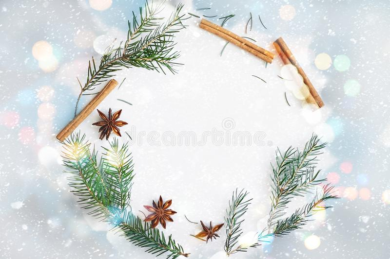 Christmas and New Year round frame wreath composition. Fir branches, star anise, cinnamon on pastel blue background royalty free stock photo