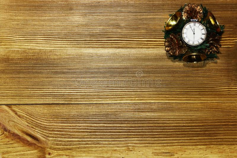 Christmas rural still life.Countdown to midnight. Retro-style watches counting the last minutes before Christmas or New Year. Christmas rural still life royalty free stock image