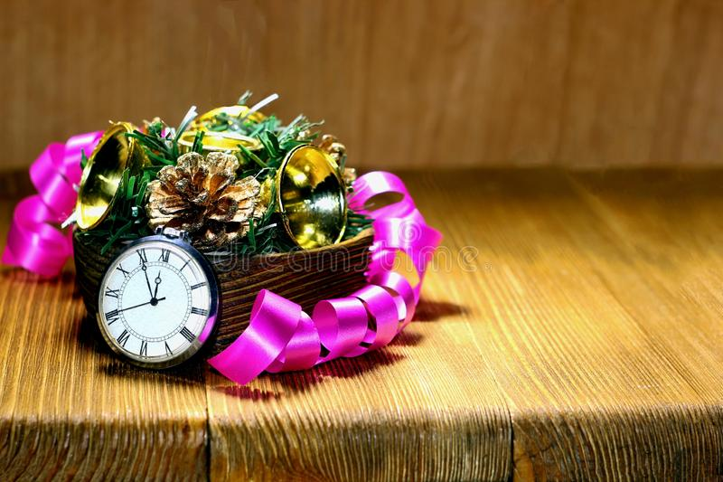 Christmas rural still life.Countdown to midnight. Retro-style watches counting the last minutes before Christmas or New Year. Christmas rural still life royalty free stock photos