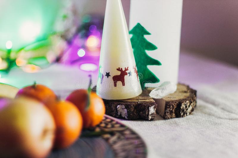Christmas rustic table with candle with reindeers and felt tree royalty free stock photos