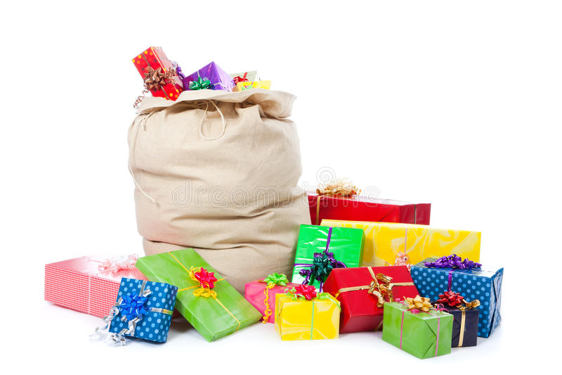 Christmas sack on white with many gifts royalty free stock photos