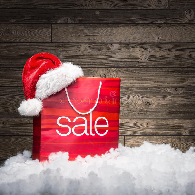 Free Christmas - Sale Bag , Rebate ,on Wood Background Royalty Free Stock Images - 61847319