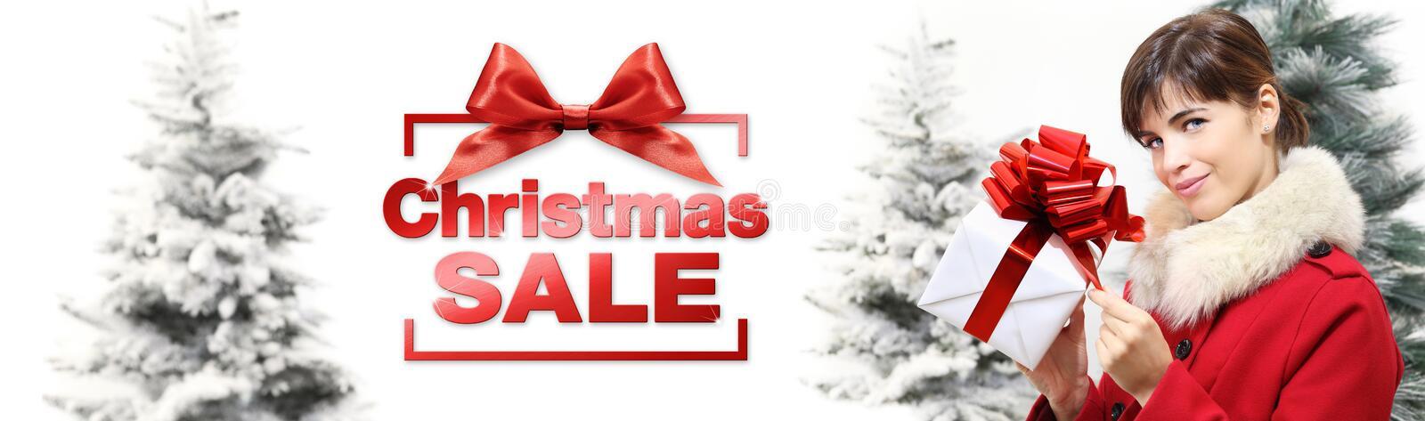 Christmas sale banner woman with gift box on white background wi. Th snowy trees stock photography