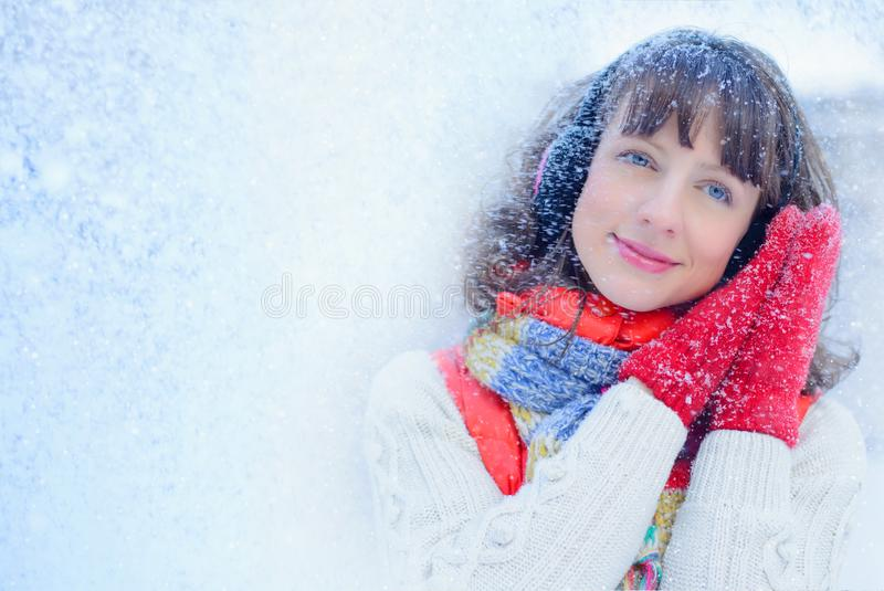 Christmas sale. Beautiful surprised woman in red mitts and white sweater winter background with snow, emotions. Funny laughter wom royalty free stock photos