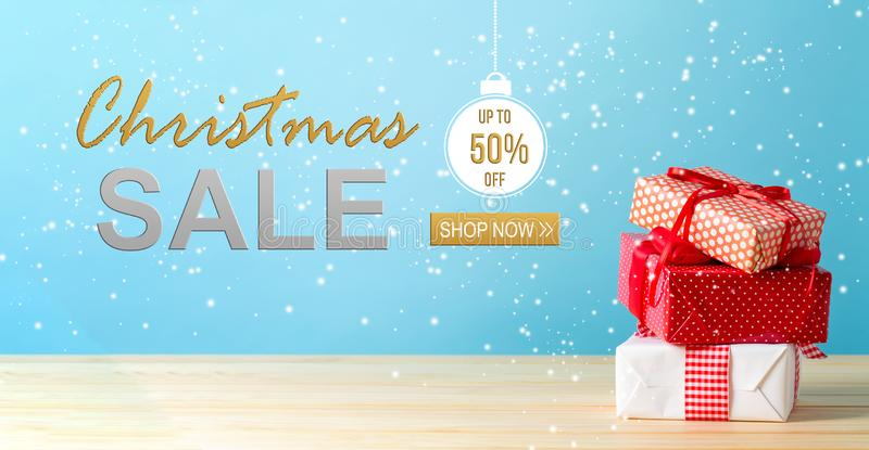 Christmas sale message with Christmas gift boxes royalty free stock photos