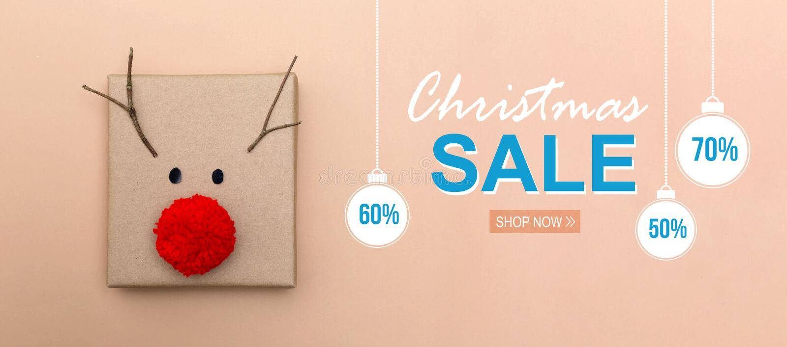 Christmas sale message with a reindeer gift box stock images