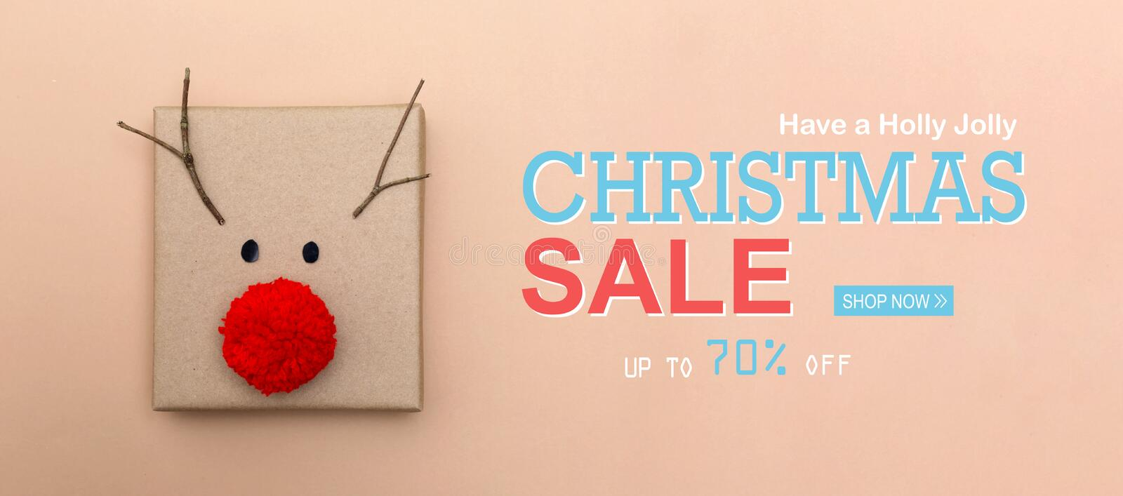 Christmas sale message with a reindeer gift box stock photo