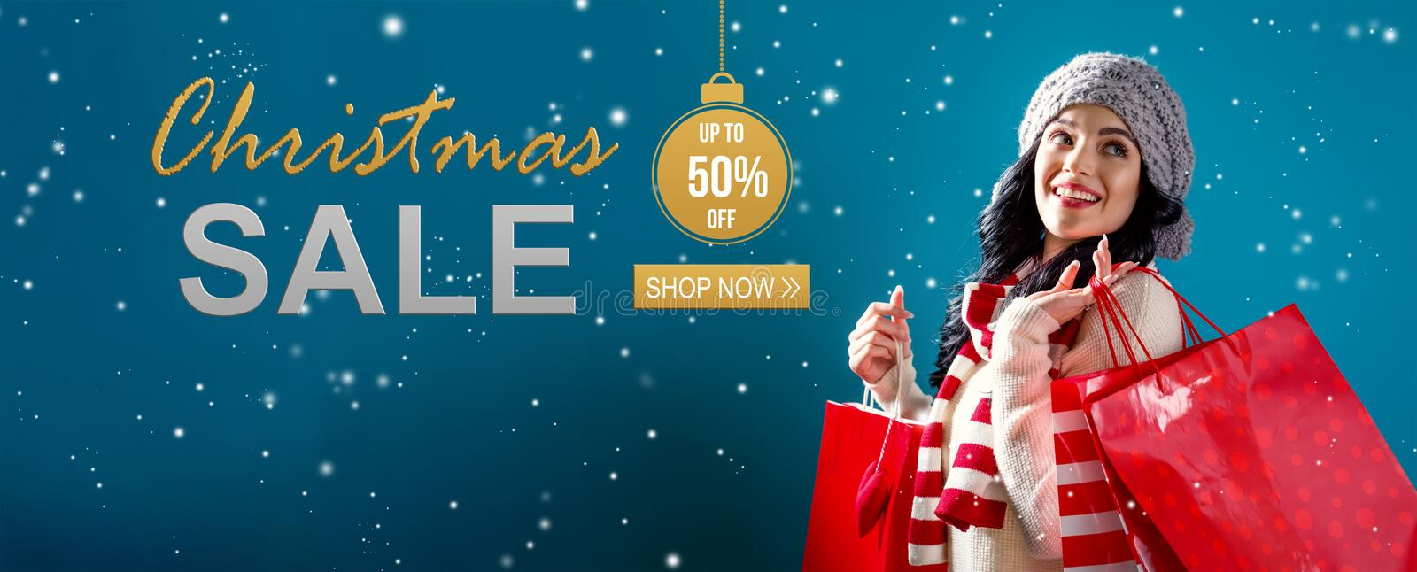 Christmas sale message with woman holding shopping bags. Christmas sale message with young woman holding shopping bags royalty free stock photo