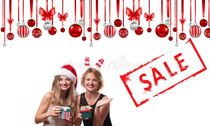 Christmas sale. Holiday. Beautiful girls in santa hat royalty free stock photo
