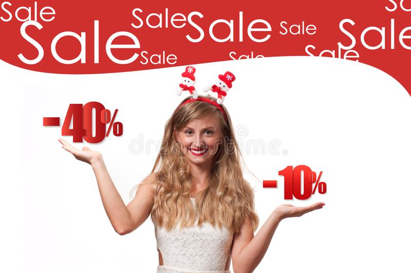 Christmas sale. Beautiful womanin santa hat. Holiday sale royalty free stock image