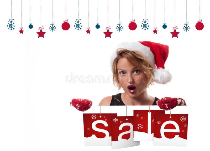Christmas sale. Holiday. Beautiful woman in santa hat royalty free stock image