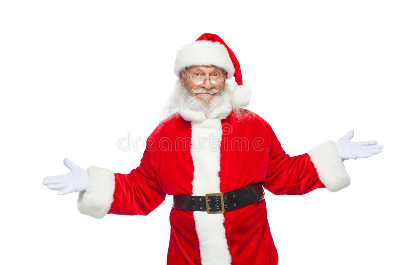 Christmas. Sales, marketing, discount, advertising, gifts. Santa Claus gestures with his hands as if he is holding stock images