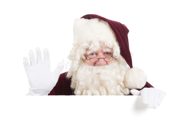 Christmas Santa Claus. Santa Claus with white message board gesturing stock photography