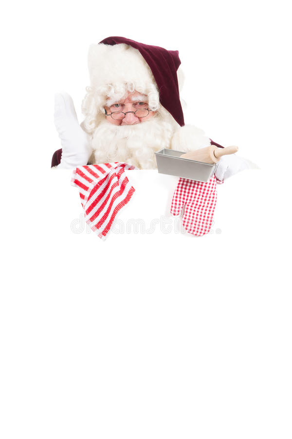 Christmas Santa Claus as cook. Santa Claus with baking attributes white message board stock image