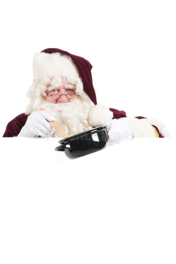 Christmas Santa Claus cooking. Santa Claus with white message board royalty free stock photos