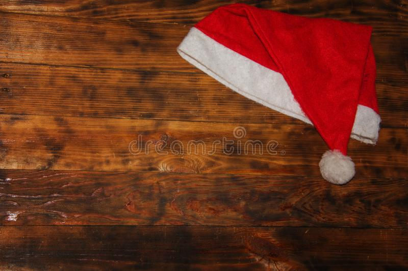 Christmas Santa Claus Hat On Dark Grunge Wooden Background., Xmas or Happy New Year Concept royalty free stock photos