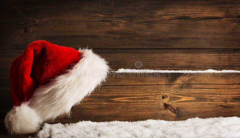 Christmas Santa Claus Hat Hanging On Wood Plank, Xmas Concept stock photo
