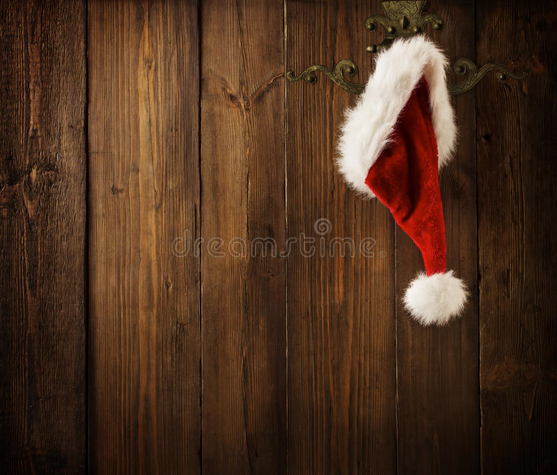 Christmas Santa Claus Hat Hanging On Wood Wall, Xmas Concept stock photos