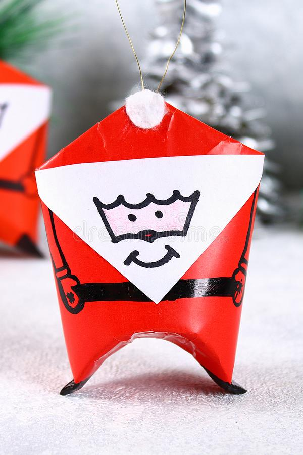 Christmas Santa Claus made from toilet paper hub. DIY toy on the Christmas tree. Christmas Santa Claus made from toilet paper hub, colored paper, marker, glue royalty free stock photography