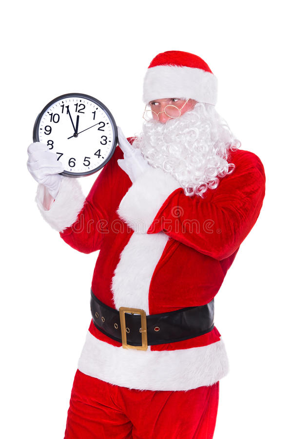Christmas Santa Claus pointing at clock showing five minutes to midnight. Isolated on white background. stock image