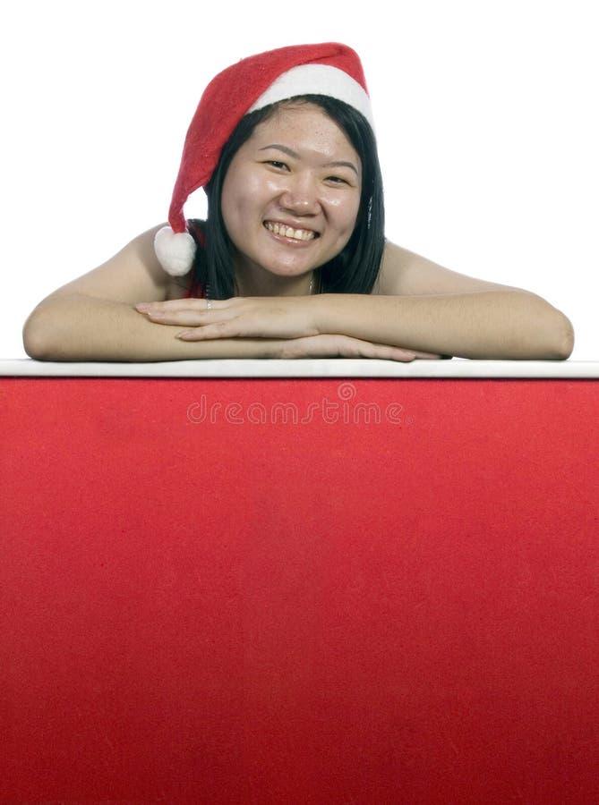 Christmas Santa Girl Holding A Notice Board-1 royalty free stock photography