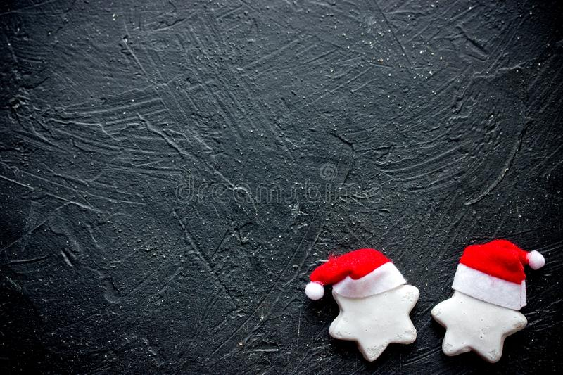Christmas santa hat cookies on black stone background royalty free stock photos
