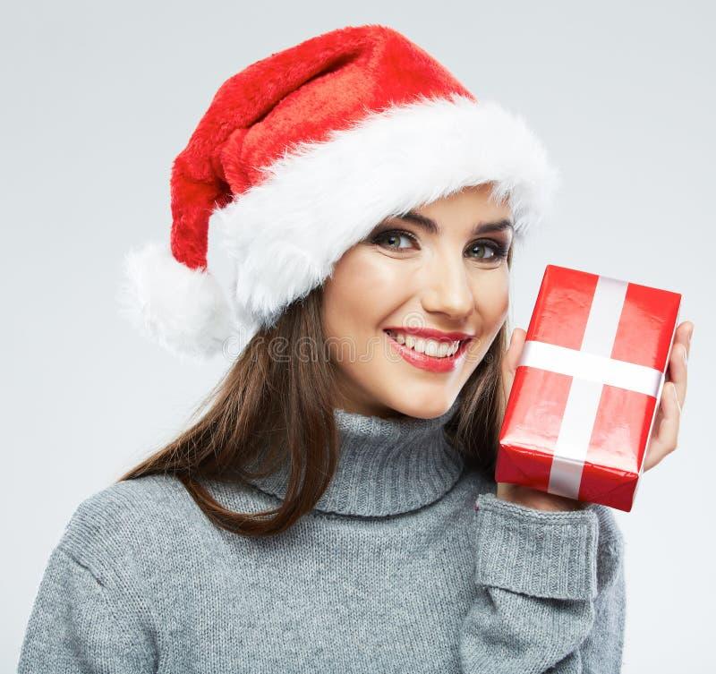 Christmas Santa hat isolated female portrait. Woman Santa. Chri. Stmas gift. Smiling happy girl on white background stock images