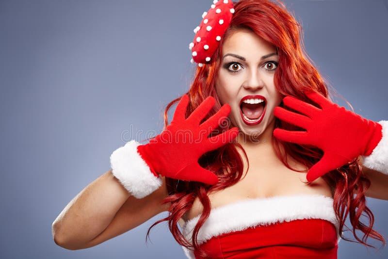 Christmas Santa hat redhair woman portrait . royalty free stock photo