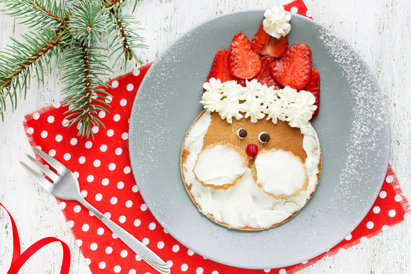 Christmas Santa pancake with strawberry for kid breakfast. Top view royalty free stock photos