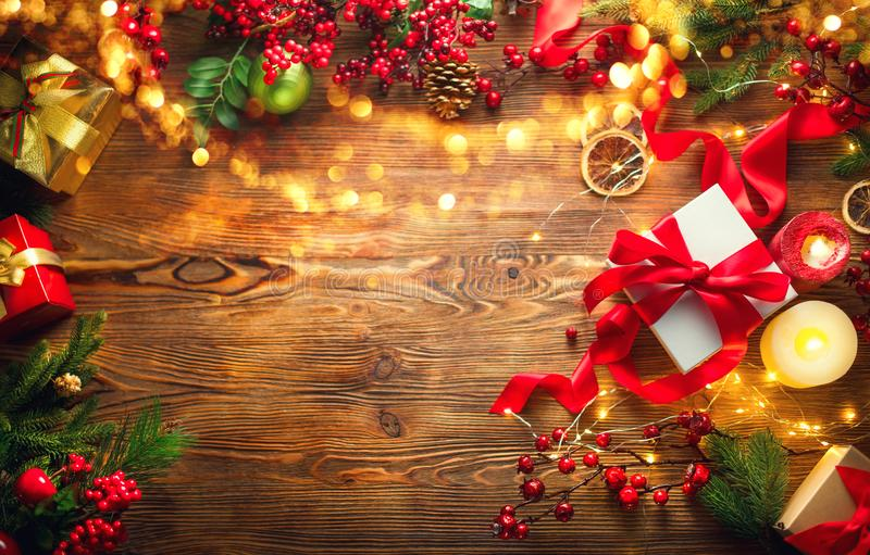 Christmas scene. Colorful wrapped gift boxes, beautiful Xmas and New Year backdrop with gift boxes, candles and lighting garland royalty free stock images