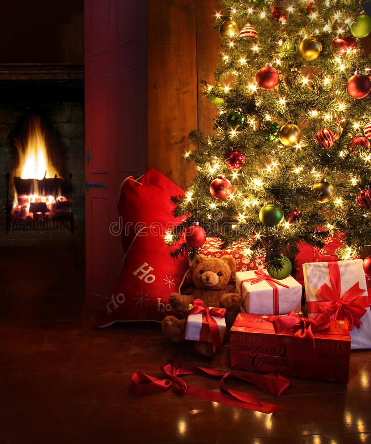 Christmas scene with tree and fire in background stock photography