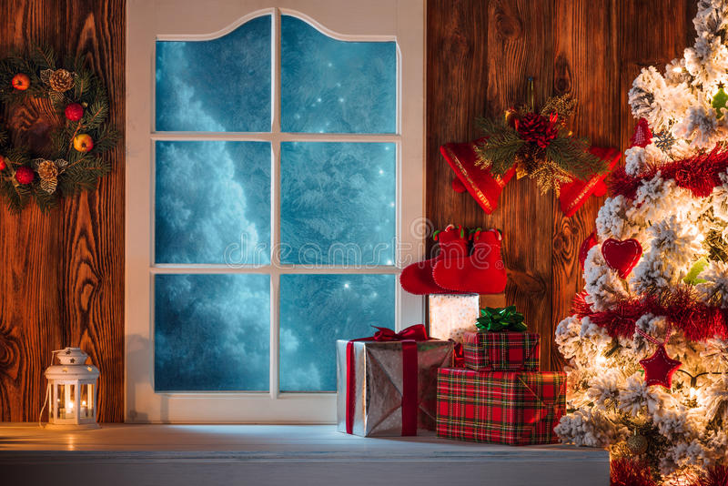 Download Christmas Scene With Tree Gifts And Frozen Window Stock Photo - Image of holiday, greeting: 62488678