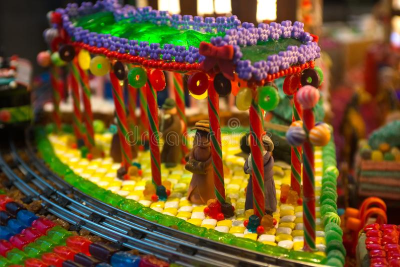 Close-up details of gingerbread Christmas scenery with human figurines dressing up the traditional vintage winter clothes standing stock photos
