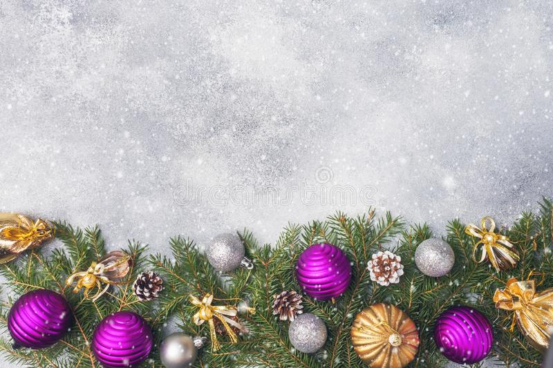 Christmas scenery, toys and branches fir on grey background. New Year concept Copy space.  stock photos