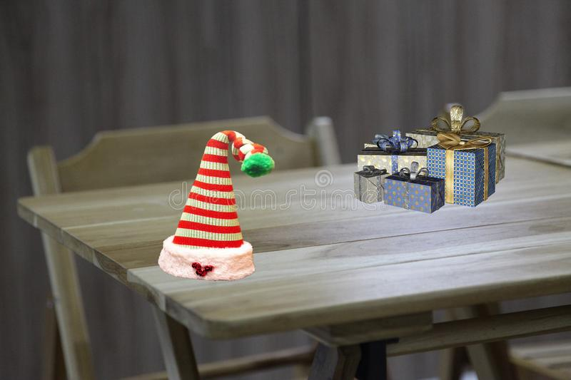 Christmas a school table decorated with christmas presents and a striped elf hat stock photography