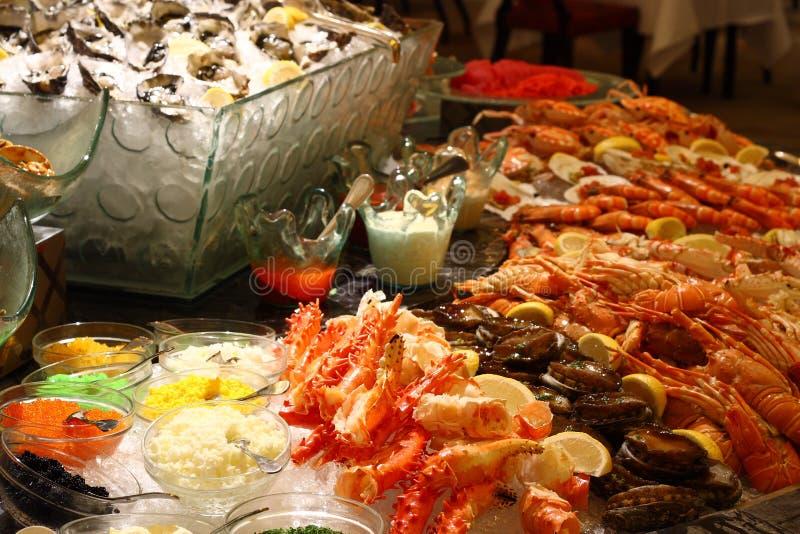 Christmas seafood buffet. Lemon shrimp and so on royalty free stock photography