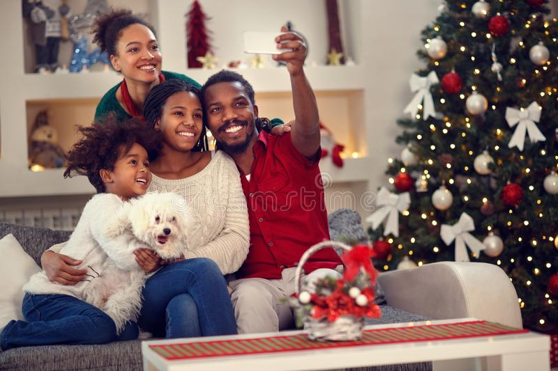 Christmas selfie - Afro American family making selfie stock photography