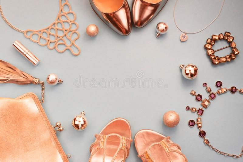 Christmas Set of fashion accessories flat lay shoes handbag necklace jewelry gold color on blue grey background Top view copy spac royalty free stock images